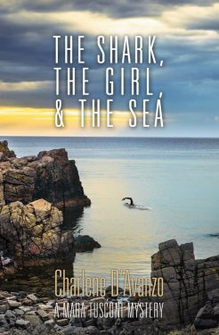 The Shark, The Girl, and The Sea Book Cover:An image of woman swimming alone in a wet suit in calm but ominous sea near steep rock cliffs.